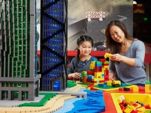 mom and daughter playing lego