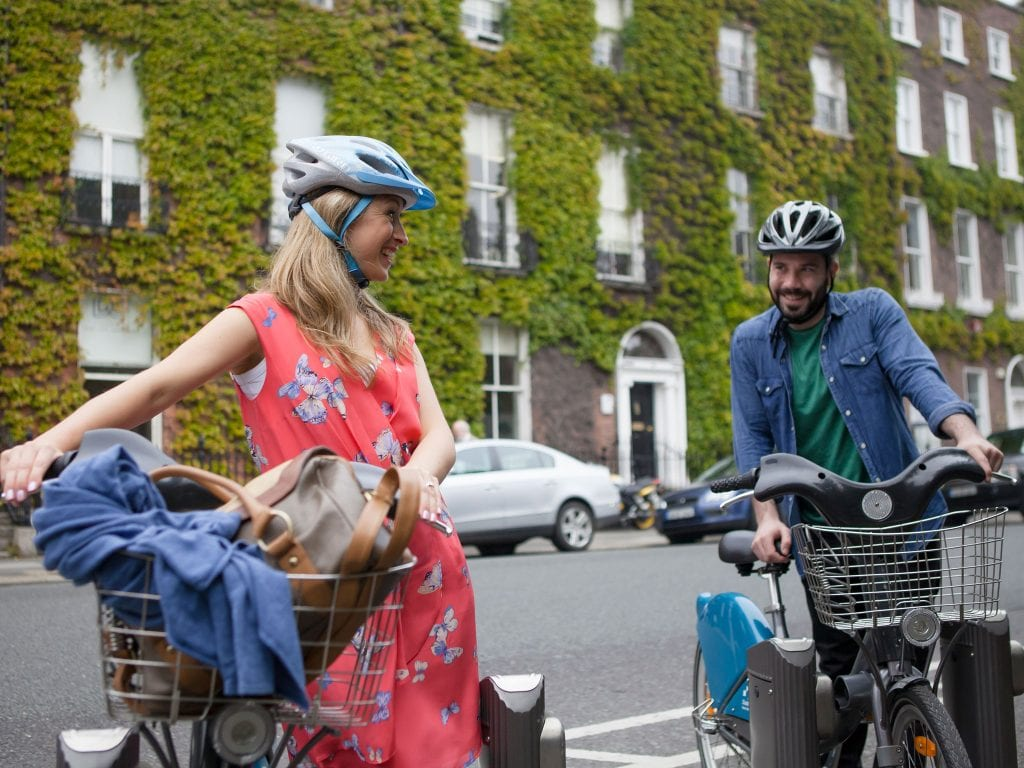 Couple biking in Dublin
